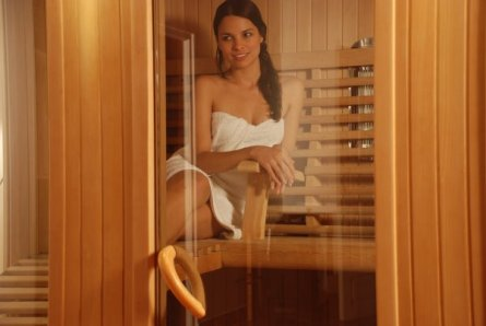 Girl Relaxing in Vitra Combination Infrared and Hot Rock Sauna
